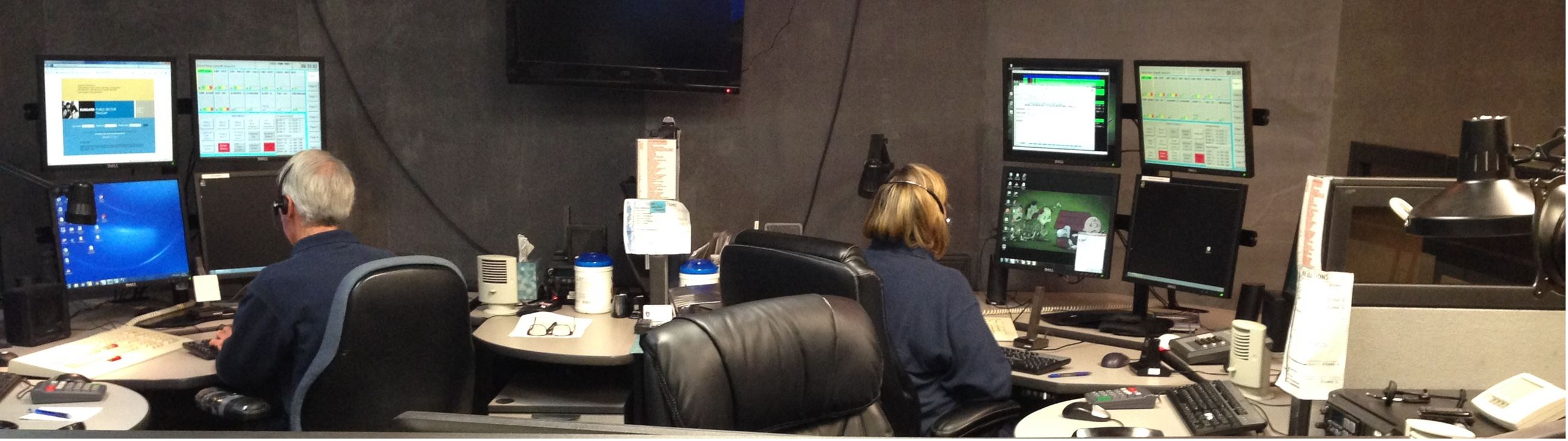 Communications Center - two dispatch officers at their desks taking calls